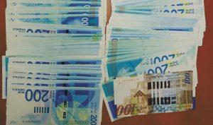 חלק מהכסף המזומן (צילום: דוברות המשטרה)