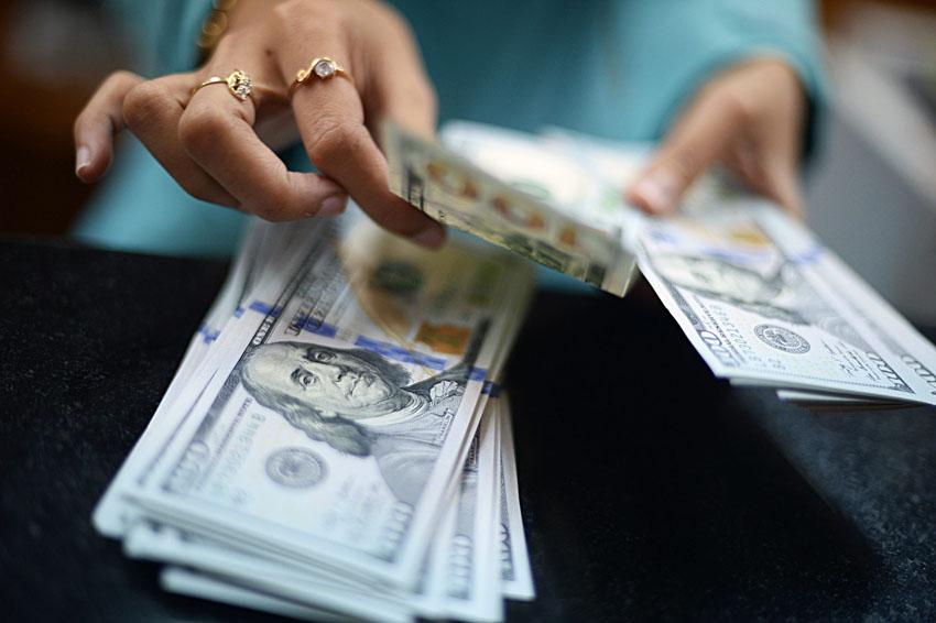 דולרים, צ'יינג' (צילום אילוסטרציה: Bloomberg)