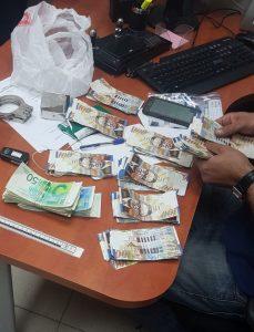 כסף שנגנב מחנות בגדים (צילום: דוברות המשטרה)