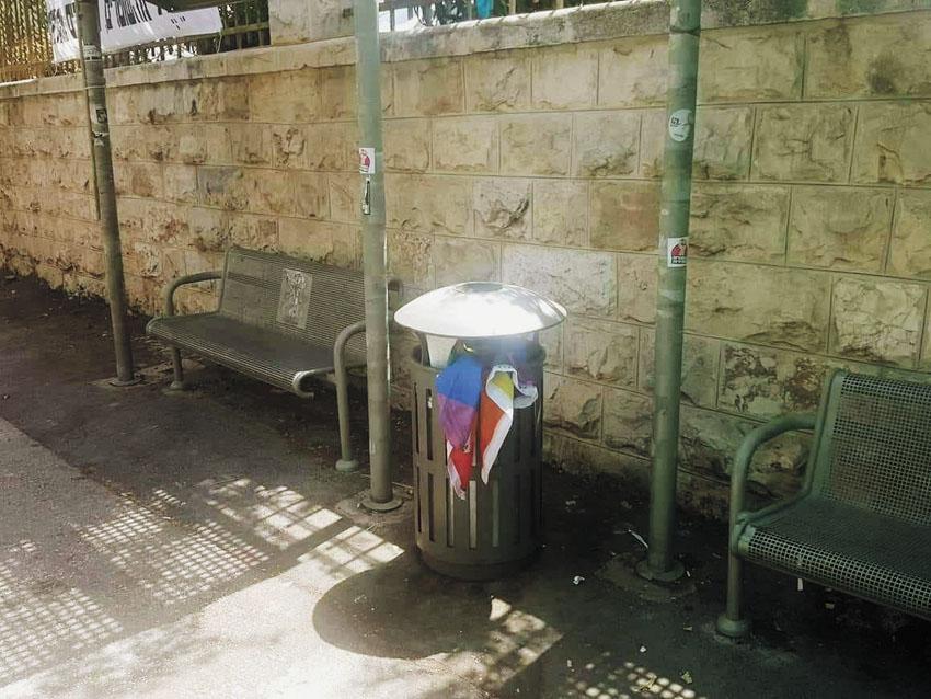 """דגל הקהילה שהושלך לפח האשפה (צילום: יח""""צ)"""