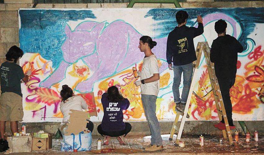 """הגרפיטי ברחוב הע""""ח במוסררה (צילום: באדיבות המנהל הקיהלתי מורשה)"""
