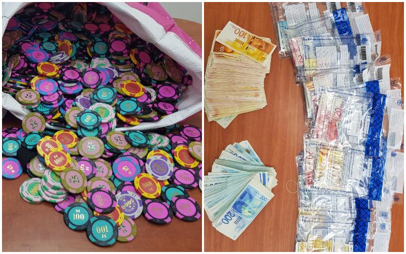 הכסף המזומן ואסימוני המשחק שנתפסו במהלך הפשיטה (צילום: דוברות המשטרה)