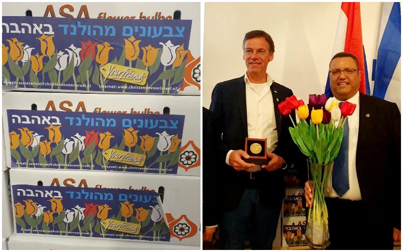 ראש העיר משה ליאון ונציג ממשלת הולנד יוהאן ואן דר-האם, פקעות הצבעונים שנתרמו לירושלים (צילומים: באדיבות עיריית ירושלים)