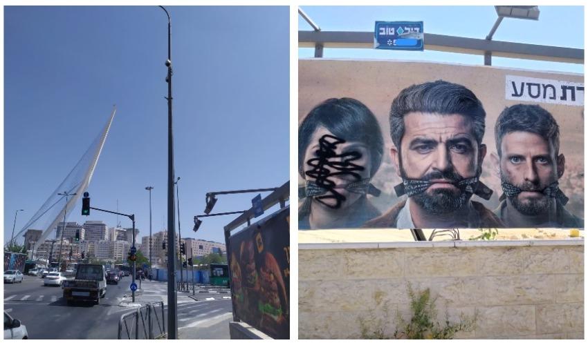 השחתת שלט פרסום באזור הכניסה לעיר, מצלמת אבטחה בסמוך (צילומים: שלומי הלר)