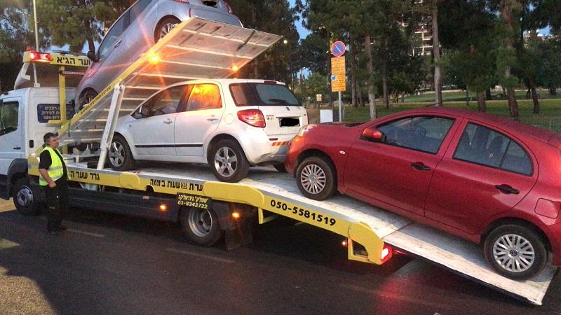 רכבים שהועברו לאחסנה (צילום: דוברות המשטרה)